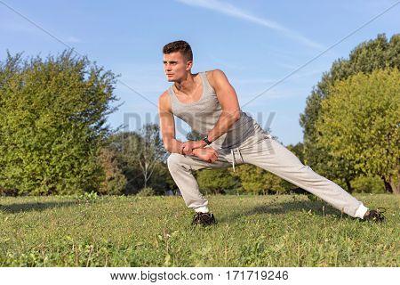 Full length of confident man exercising in park