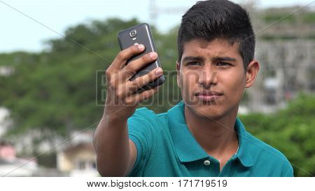 A Good Looking Teen Boy Taking Selfy