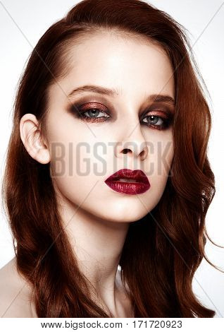 Beauty fashion model with ginger hair and red lips makeup on white background