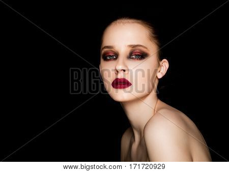 Beauty portrait red eyes and lips makeup model on black background