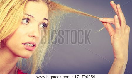 Unhappy Woman Looking At Destroyed Hair