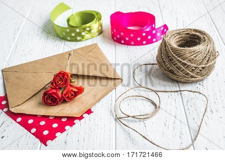 envelope and flowers on wooden background mockup