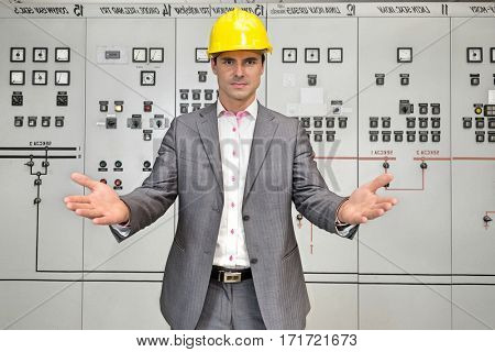 Portrait of serious young male supervisor gesturing in control room