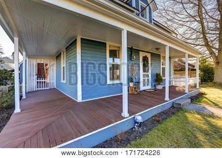 Home Exterior With Wrap Around Front Porch.