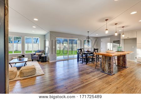 Open Floor Plan Interior With Polished Hardwood Floors