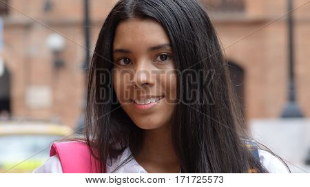 A Female Hispanic Teen With A Backpack