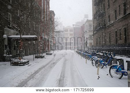 NEW YORK - FEB 9: View of Macdougal St near Waverly Place as snow falls on February 9, 2017 in New York. Snowfall totals of approximately six inches fell in and around NYC.