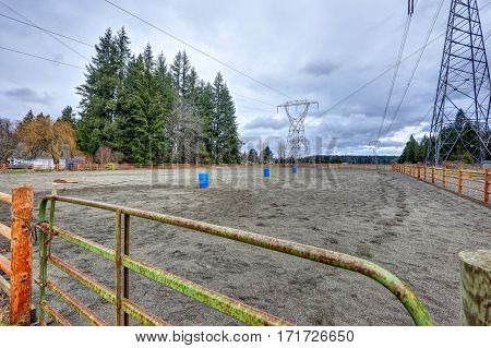 Empty Fenced Equestrian Area And Cloudy Sky Background