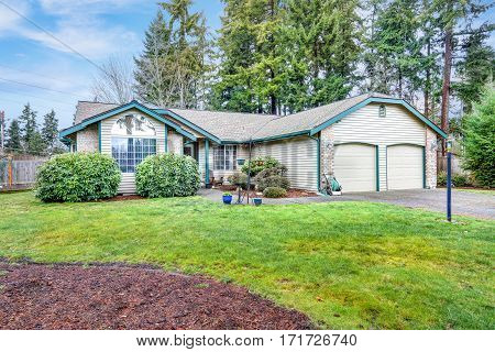 Lovely Beige Rambler House Exterior With Two Garage Spaces