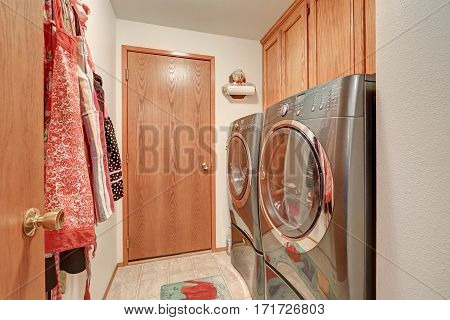 Laundry Room Interior With Modern Stainless Steel Appliances