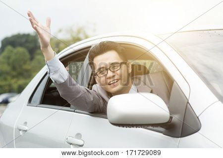 Close up portrait of angry pissed off young business man pissed off by other drivers and gesturing with hands. Road rage traffic jam concept.