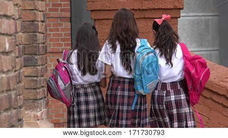 A Group of Female Teen Students With Backpacks