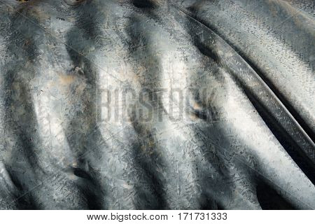 A Corrugated Grey Metal Pipe Background Texture
