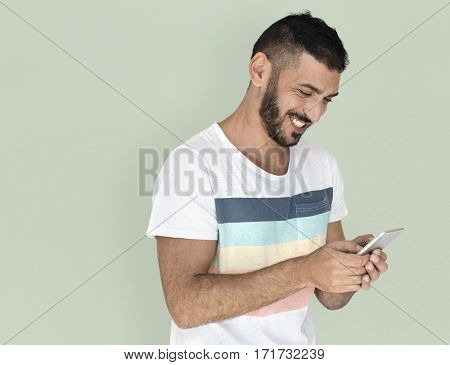 Middle Eastern Man Smiling Happiness Mobile Phone Studio Portrait