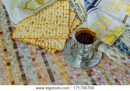 Jewish Traditional Passover Unleavened Bread And A Wine Cup With The Text Of The Traditional Wine Bl