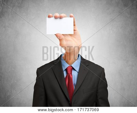 Hand-faced businessman holding a business card