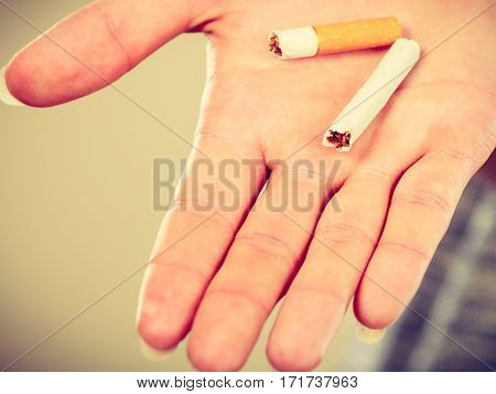 Closeup Of Broken Cigarette On Male Hand.