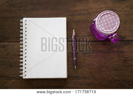 Notepaper pen and drink on wooden table stock photo