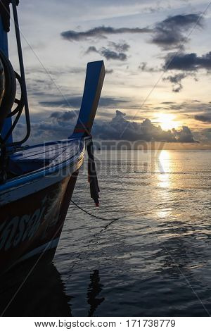 Calm sea view on the background of protruding nose Thai fishing boat. Dark tone.
