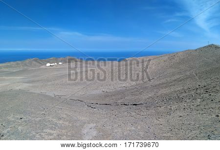 PATACHE CHILE 11 JANUARY 2016: view to desert ocean and scientific station