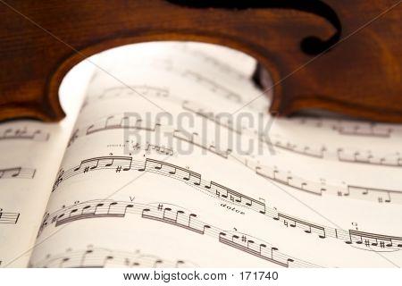 Light Through Violin's Ribs On Music Score