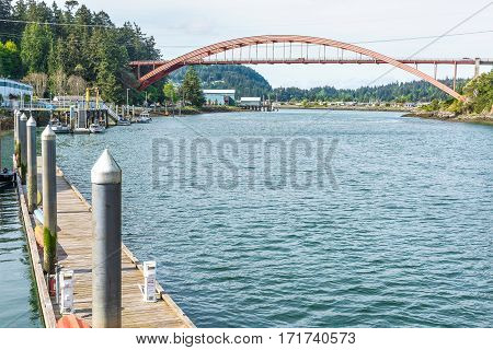La Conner, USA - April 21, 2016: Famous bridge with boats and waterfront waterway bay Swinomish channel in historical village in Washington State