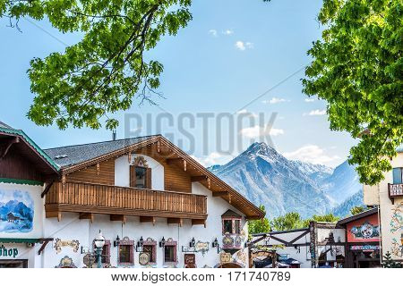 Leavenworth, USA - April 30, 2016: Rooftops of Bavarian Village in Washington with restaurants and mountains