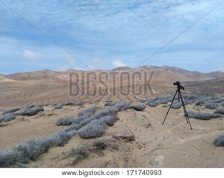 DSLR camera on a tripod in a desert