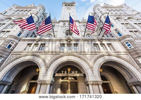 Washington DC, USA - January 28, 2017: Trump International Hotel and the Old Post Office Tower entrance with american flags