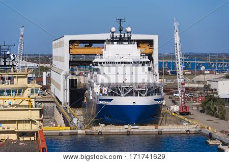 Tampa Florida - February 11th 2016: Ocean going vessel in dry dock for repairs February 11th Tampa Florida