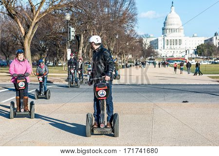 Washington DC, USA - January 28, 2017: Group of people on segways in front of Capitol congress building