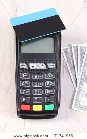 Payment Terminal With Contactless Credit Card And Currencies Dollar, Cashless Paying For Shopping Or