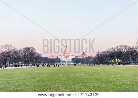 Washington DC, USA - October 2, 2016: United States Congress capital building with national park park and pink purple sunset