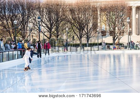 Washington DC, USA - January 28, 2017: Two young girls skating in ice rink in National Gallery of Art Sculpture garden