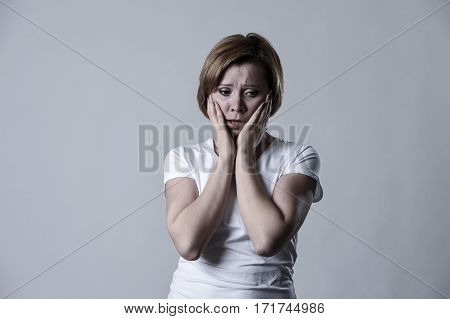 young devastated depressed woman crying sad feeling hurt suffering depression in sadness emotion gesturing helpless in pain face expression isolated background desperate