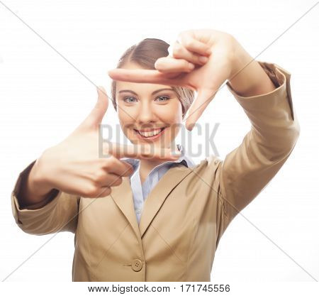 businesswoman creating a frame with fingers isolated on white