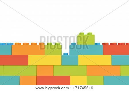 3d rendering of colorful wall made of many toy bricks with one piece staying unused on white background. Games and toys. Puzzle pieces. Building blocks.