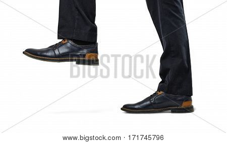 Black and brown stylish boss's feet step up close-up isolated on white background. Boss pressure. Small business problems. Fashion shoes