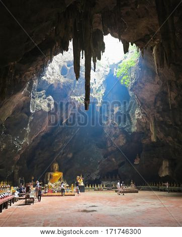 Phetchaburi, Thailand - January 7 2017: Tham khao luang cave temple is very beautiful temple inside of the cave. The sunshine penetrates from the top make inside even more beautiful.