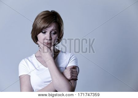 portrait of young beautiful woman on her 30s sad thinking depressed looking low and tormented feeling worried suffering breakdown isolated background in depression emotion