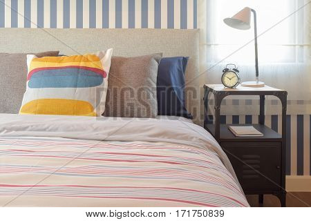 Colorful Style Bedding Bedroom Interior And Clock On Bedside Table