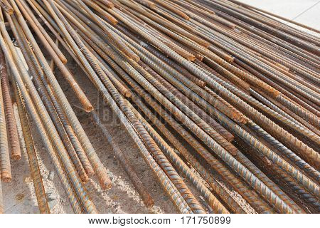 close up of rusty rebar waiting for construction