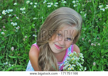 Portrait of a little girl on a green background. Girl seven years.