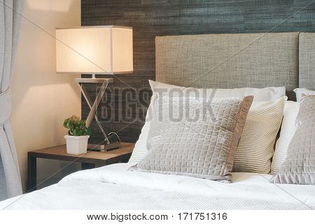 Hotel Style Bedding With White Shade Reading Lamp