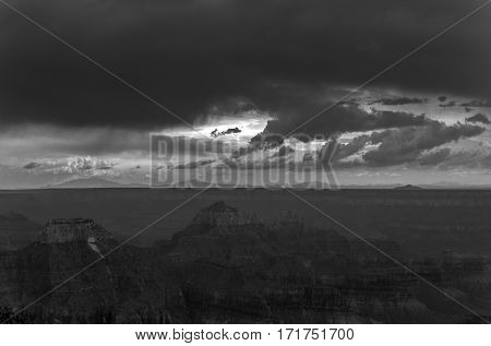 A black and white photo of a storm approaching over the Grand Canyon.