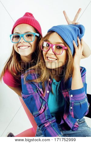lifestyle people concept: two pretty stylish modern hipster teen girl having fun together, happy smiling making selfie close up
