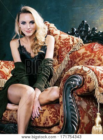 Photo of sexy blonde young girl looking at camera, smiling. very slim in luxury interior, lifestyle people concept close up