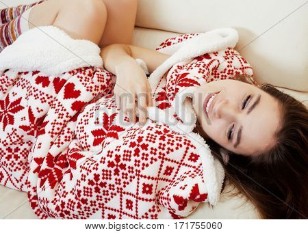young pretty brunette girl in Christmas ornament blanket getting warm on cold winter, freshness beauty concept close up