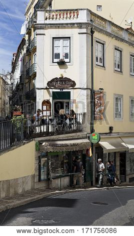 LISBON, PORTUGAL - September 26, 2016: Tourists on a coffee shop terrace in the old city of Lisbon Portugal