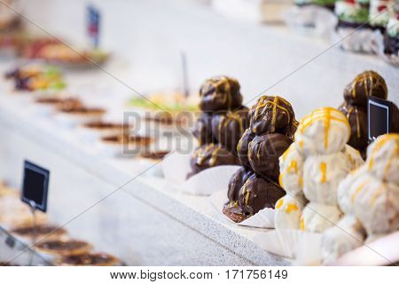 Close-up of desserts in display at supermarket